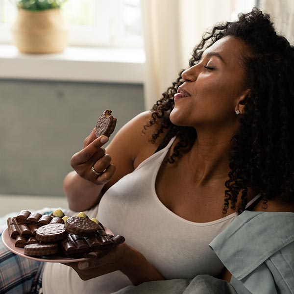 A lady eating Chocolates