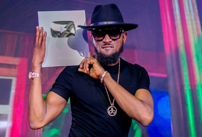 Dbanj receives a Silver Play Button Award in recognition of achieving 100,000 subscriptions to his YouTube channel at the YouTube Week Event that held in Lagos recently.