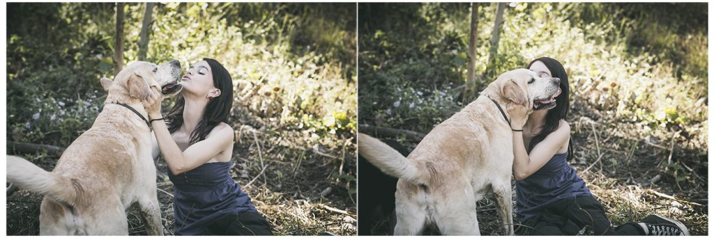 chica besa a perro labrador