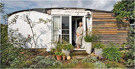 Elspeth  standing outside her 'Green House'