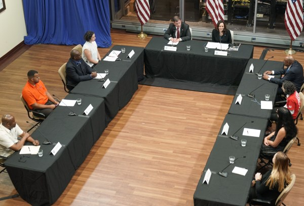 Secretary Marty Walsh and Vice President Kamala Harris seated at a roundtable with workers.