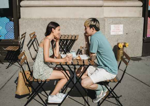 happy diverse couple having breakfast at table