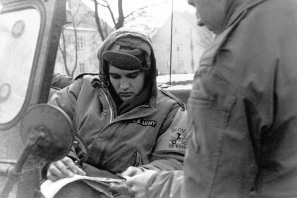 Electronically Reprocessed Stere: photo of Elvis in Army jeep in Germany during winter 1958.