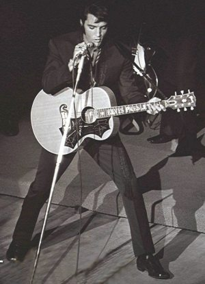 Fifty Generations Of Elvis Fans: photo of Elvis on stage in Las Vegas in 1969.
