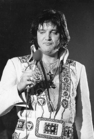 Fifty Generations Of Elvis Fans: photo of Elvis on stage in the 1970s.