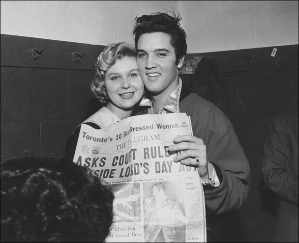 Elvis poses with Miss Toronto Judy Welch.