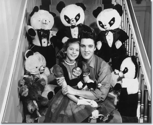 Eight-year-old Mary Kosloski had a date with Elvis Presley Jan. 8, 1958, and he kept her waiting for more than two hours. The Collierville girl, who was the national March of Dimes poster child in 1955, seemed to forgive all when Elvis appeared and told her: 'If you were 10 years older, honey, I wouldn't let you go'.