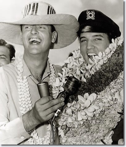 KPOI-AM DJ Tom Moffatt and Elvis presley : Saturday, April 7, 1962. Arriving at Honolulu Airport for location filming in Hawaii for Paramount's Girls! Girls! Girls!
