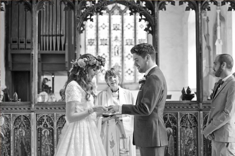 english countryside barn wedding bride groom exchange rings