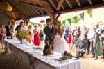english countryside barn wedding bride groom cut cake