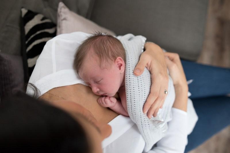 natural newborn family photography cuddles mummy