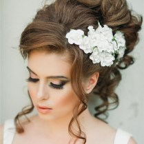 Gallery Loose Wavy Wedding Updo With White Flower Headpiece