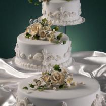 Tier Cake On A S Shaped Stand With Bride And Groom Figurine