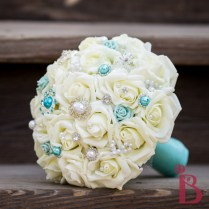 Aqua Blue Jeweled Brooch Bouquet With Cream Roses