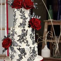 Black And White Wedding Cake With Red Flowers