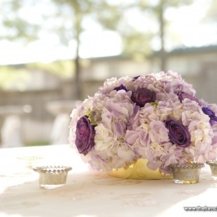 Low Centerpiece With Fresh Blue Curiosa Roses And Light Purple