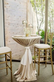 A Courtyard Setting With 2 Tables For 4 And 3 Fabric Draped Bar