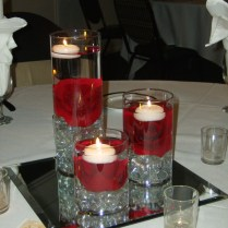 Interior Cylinder Glasses With Red Rose Inside And White Candles