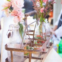 Pink Flowers Were Placed In Vintage Milk Bottles For A Sweet