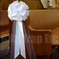 Church Pews Decorated For Wedding