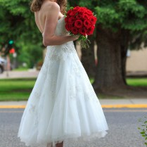 Tea Length Wedding Dress With Birdcage Veil And Red Shoes
