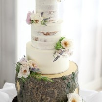 Cake Flowers With Roses And Lavender On A Rustic Log Cake By