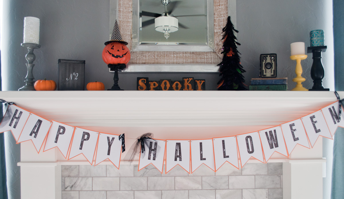 With a little imagination, you can create a Halloween mantle on a next to nothing budget!