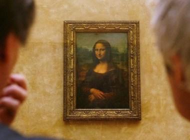 Two men in art gallery looking at mona lisa