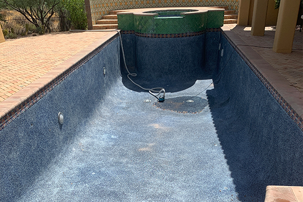 buildup on bottom of pool before acid wash