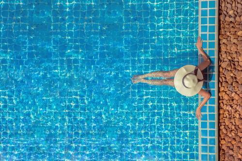 woman relaxing in clean pool water