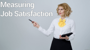A Beautiful woman whose left is holding a tablet and the other hand is pointing to measuring job satisfaction