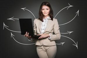 Beautiful woman holding a laptop