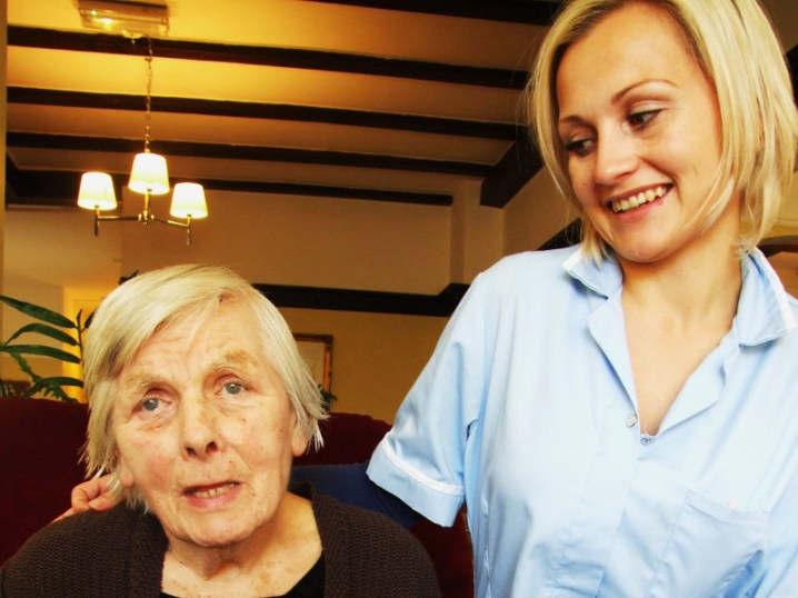 Female Client with Smiling Female Staff Member