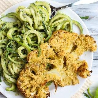 Vegan Parmesan Cauliflower Steaks over Hemp Pesto Zoodles