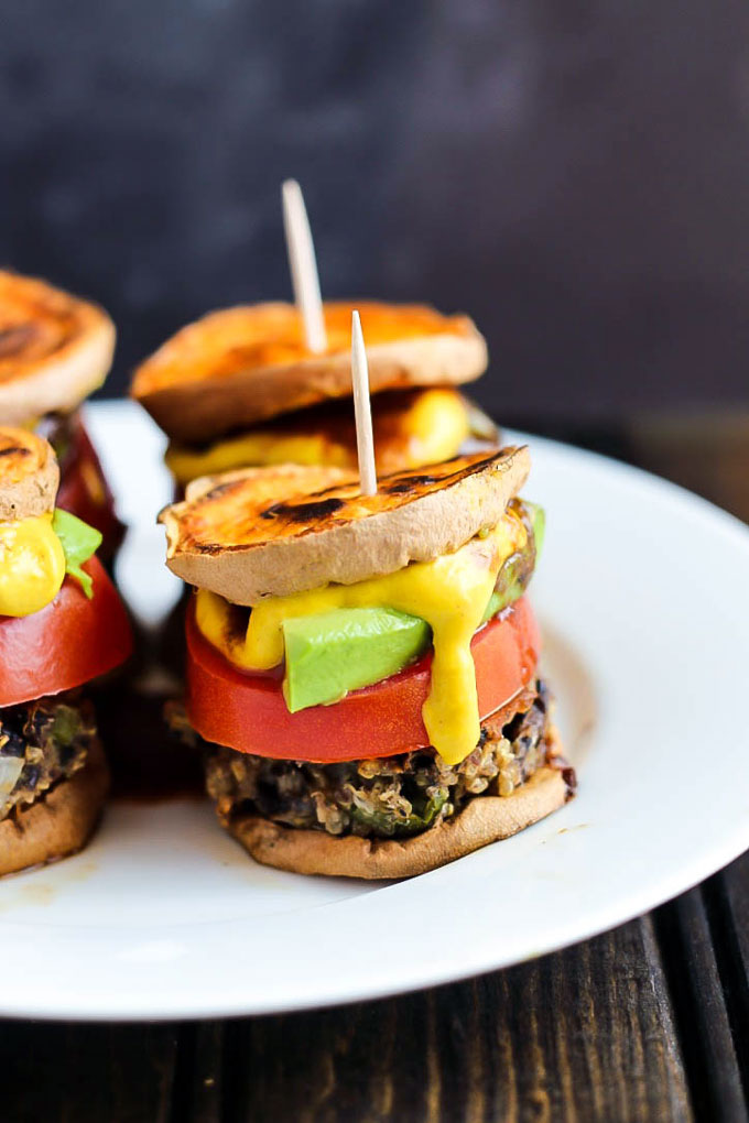 Hearty veggie burgers on sweet potato buns make these Vegan Sweet Potato Sliders a great party appetizer! Have fun with the toppings. Healthy & gluten-free!