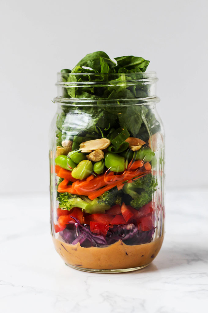 Pack one of these 5 vegan mason jar salad recipes for a healthy lunch on-the-go! They're easy to assemble ahead of time & full of nutritious ingredients.