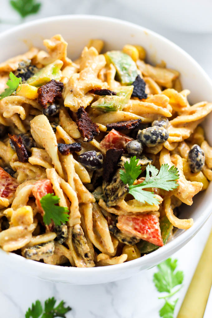 This Creamy Vegan Mexican Pasta Salad is packed with spicy flavor, vegetables and healthy fats to satisfy you at meal time. Only 30 minutes of prep time!