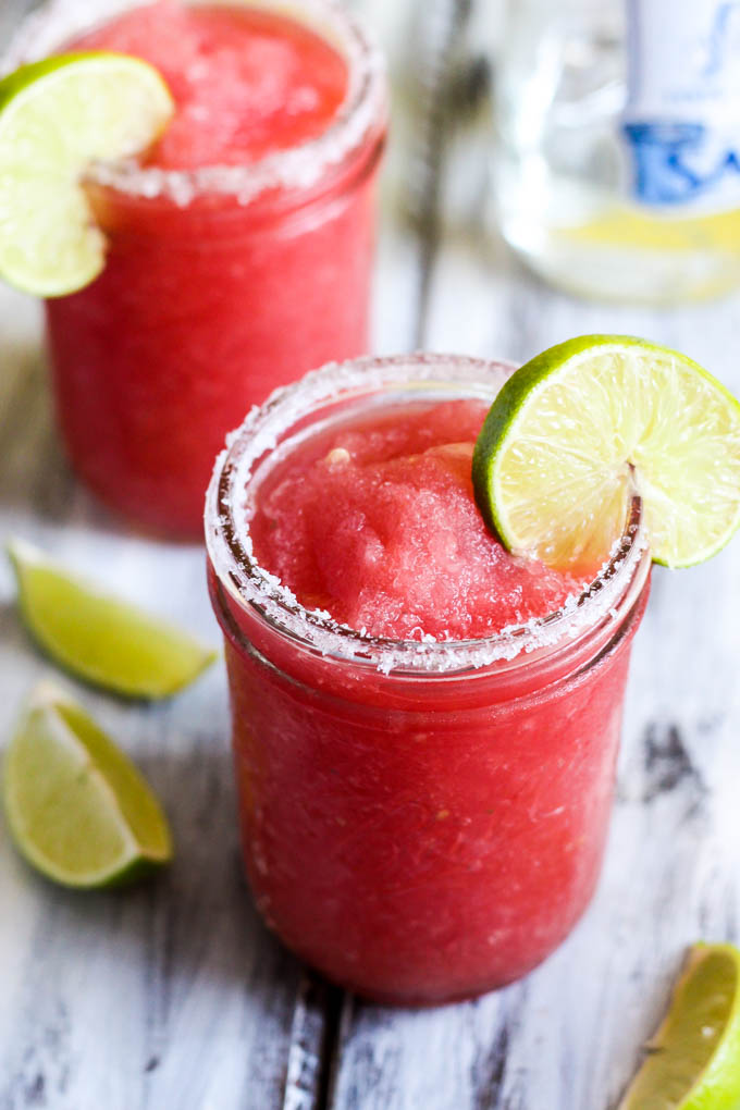 This Frozen Watermelon Margarita is your new go-to summertime drink! It's fruity, refreshing & made with only five ingredients. Perfect with chips & salsa!