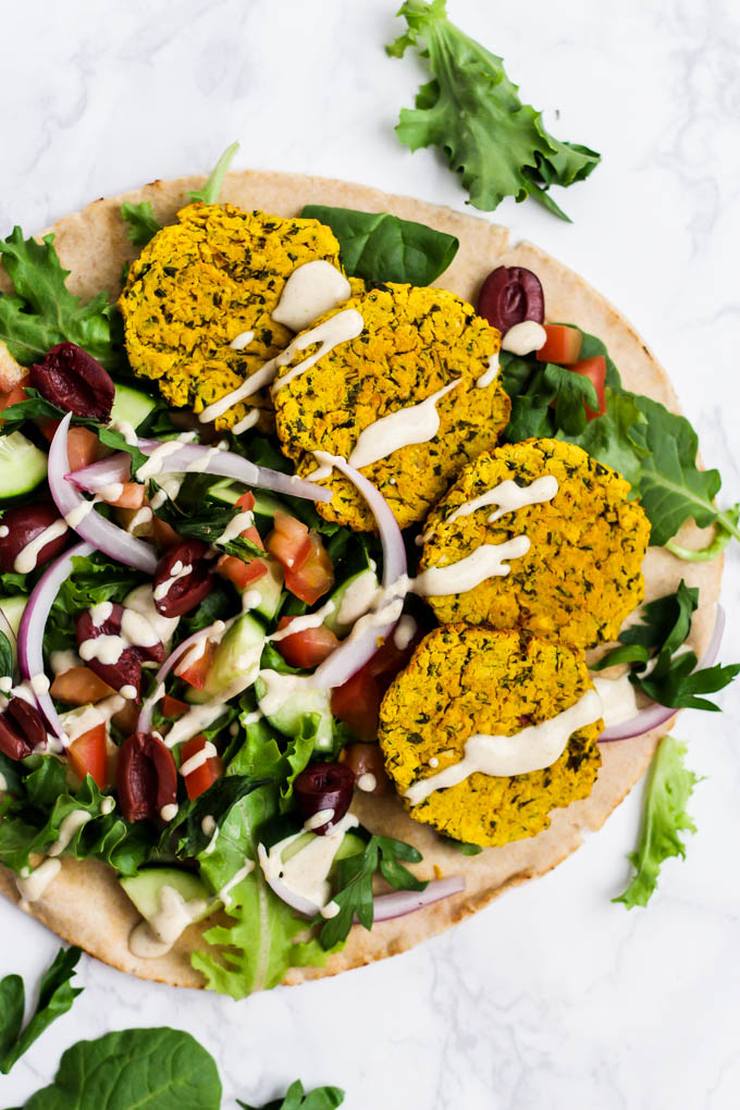 Add a pop of color to your Mediterranean dishes with this easy Turmeric Baked Falafel! The perfect addition to salad, bowls or pita sandwiches. Vegan & gluten-free!