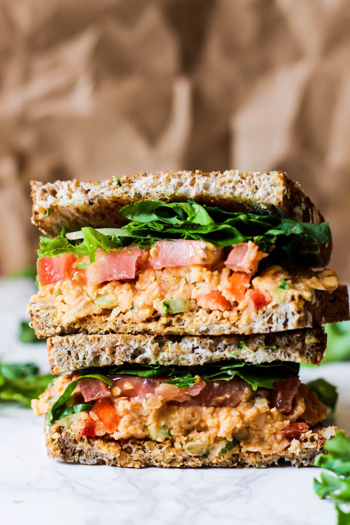 This Vegan Buffalo Chickpea Salad Sandwich is the perfect lunch to pack for adults or kids! It's full of vegetables, beans and grains to keep you satisfied.