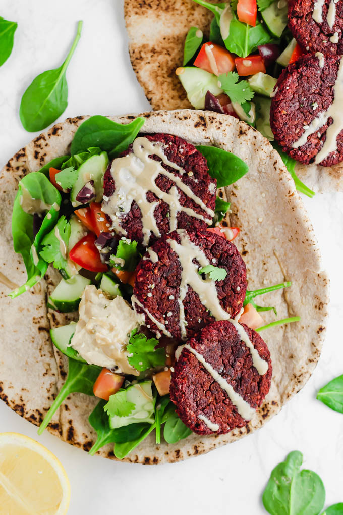 Switch up traditional falafels with these colorful, veggie-packed Beet Falafel Bowls and Pita Sandwiches! Everything comes together in 30 minutes for a wholesome dinner or on-the-go lunch. (vegan & gluten-free)