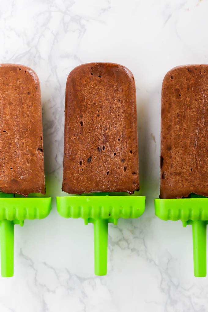 No one will guess the secret ingredient in these creamy Avocado Chocolate Fudge Pops! Full of healthy fats, these popsicles are the perfect sweet treat for the summer. (vegan & gluten-free)
