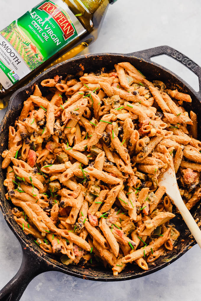 Dinner is served in 30 minutes with this One Pan Mexican Pasta Skillet with a dairy-free chipotle yogurt sauce! It's insanely satisfying thanks to 16 grams of plant protein per serving. (vegan)