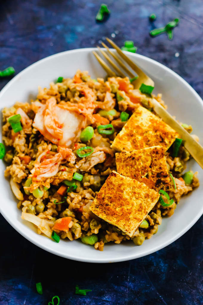 Amp up your fried rice by adding fermented kimchi in this Korean Kimchi Fried Rice recipe! It's a great way to use leftover rice, and dinner is served in an hour.