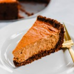 This Vegan Pumpkin Cheesecake is creamy, decadent, and a perfect dessert for the holidays. The chocolate crust adds crunch and texture. (gluten-free)