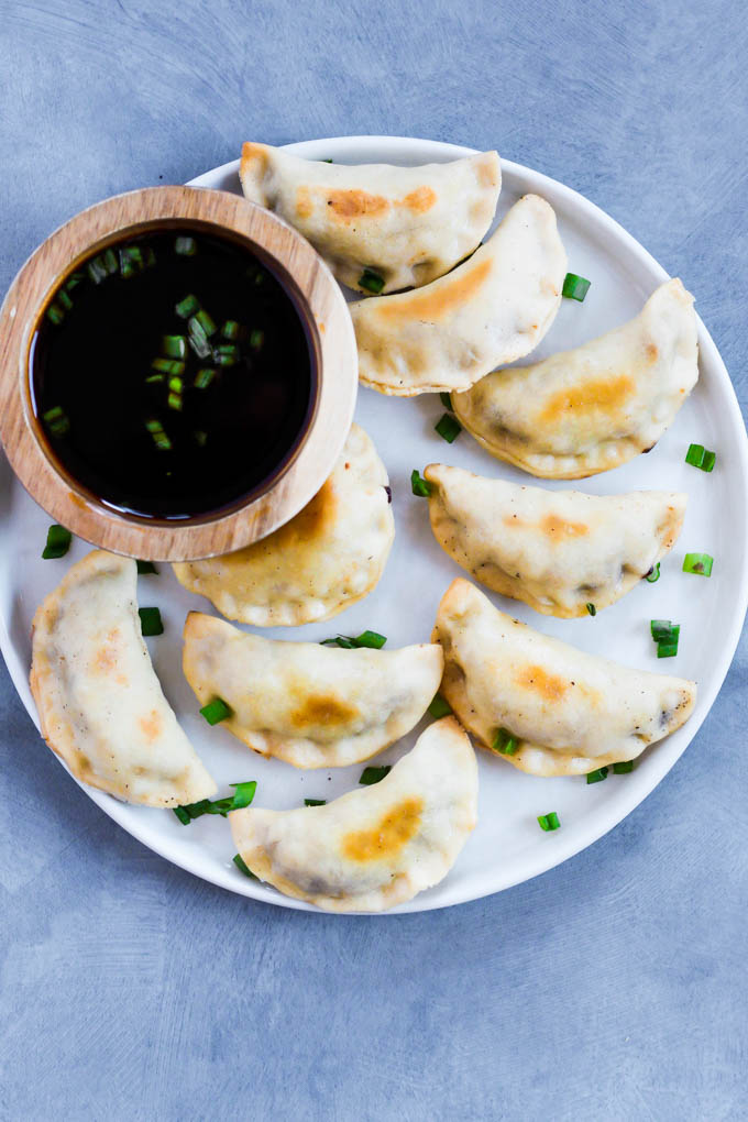 "These Sticky Tempeh Potstickers are baked, not fried, and filled with a ""meaty"" mix of tempeh and vegetables. Serve as an entree or appetizer with soy sauce for dipping! (vegan)"