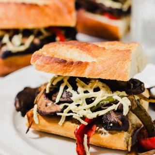 This Portobello Cheesesteak recipe will fulfill your comfort food cravings! These sandwiches are meaty (without meat) and feature gooey vegan mozzarella. They're sure to satisfy plant-eaters and carnivores alike!