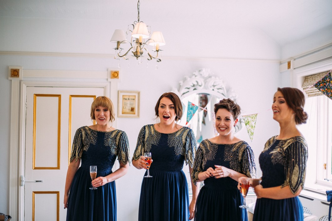 Bridesmaids wearing navy sequin dresses