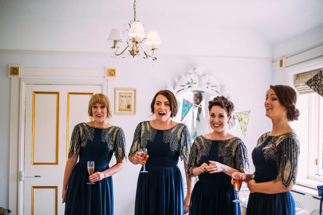 Bridesmaids wearing navy sequin dresses