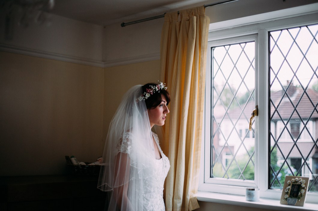 Bride wearing a flower crown and veil